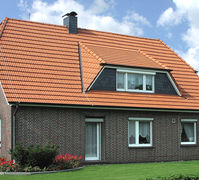 A single-family house covered with natural red Elsss tiles