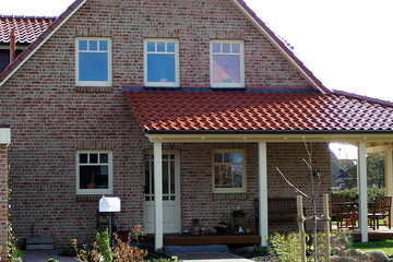 A single-family house covered with copper engobe Bornholm tiles